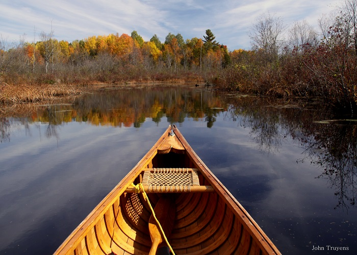 cedar canoe on water